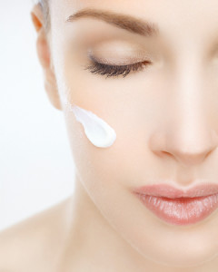 woman-with-lotion-on-face-vert